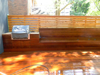 A newly finished outdoor kitchen on a wooden patio