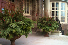 A clean porch in front of a house with urns
