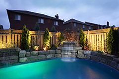 Stone Work & Landscaping Lighting Around a Pool in the Backyard