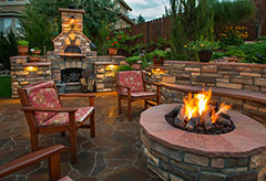 Amazing backyard with landscaping including stone work and fire pit